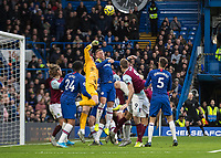 Football - 2019 / 2020 Premier League - Chelsea vs. Burnley<br /> <br /> Kepa Arrizabalaga (Chelsea FC) punches clear under the aerial pressure of Burnley at Stamford Bridge <br /> <br /> COLORSPORT/DANIEL BEARHAM
