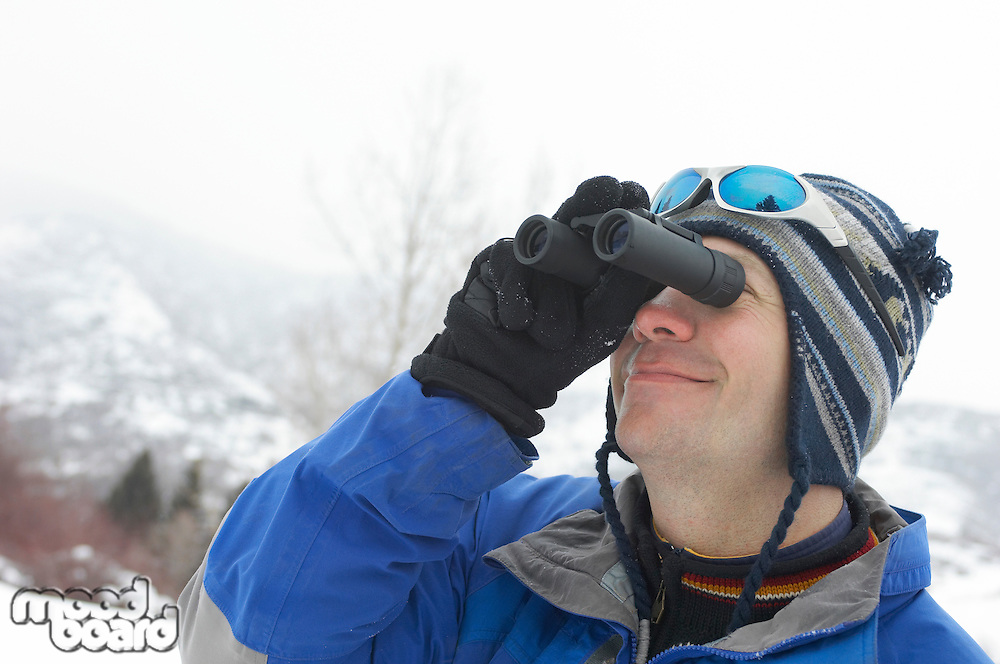 Skier Looking Through Binoculars