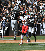 Sep 15, 2019; Oakland, CA, USA; Oakland Raiders cornerback Gareon Conley (21) bats down a pass in the first half against the Kansas City Chiefs at Oakland-Alameda County Coliseum. The Chiefs defeated the Raiders 28-10..(Gerome Wright/Image of Sport)