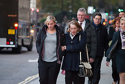 Family members of killed British soldier Lee Rigby, mother Lyn Rigby (R), sister Sara McClure (L) emotionally affected and stepfather Ian Rigby, leaving the Old Bailey court in central London on December 9, 2013 where two men are on trial accused of the soldier's murder, Old Bailey, London, United Kingdom. Monday, 9th December 2013. Picture by Daniel Leal-Olivas / i-Images