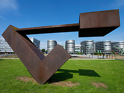 Steel sculpture and modern office buildings at Innenhafen area of Duisburg in North Rhine-Westphalia Germany