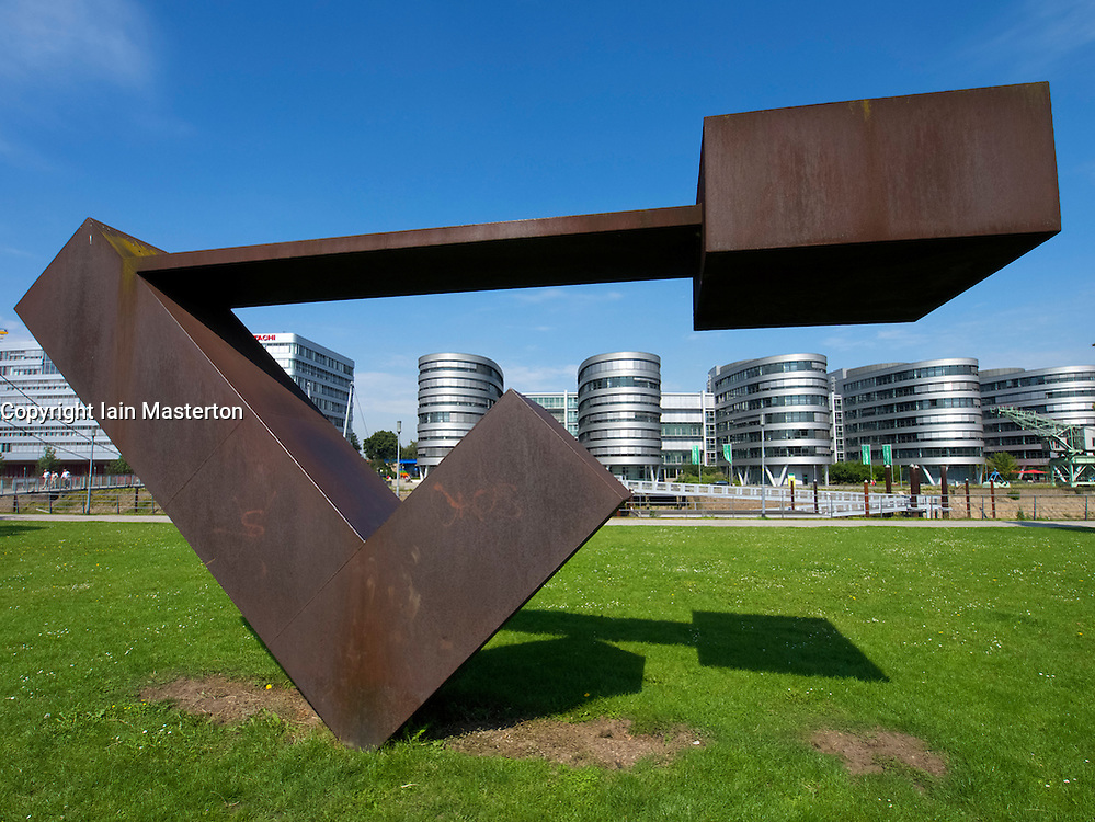 Steel sculpture and modern office buildings at Innenhafen area of Duisburg in North Rhine-Westphalia Germany