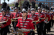 Participants in a high school marching band march in the Veterans Day Parade, which honors American military veterans, in Tucson, Arizona, USA.