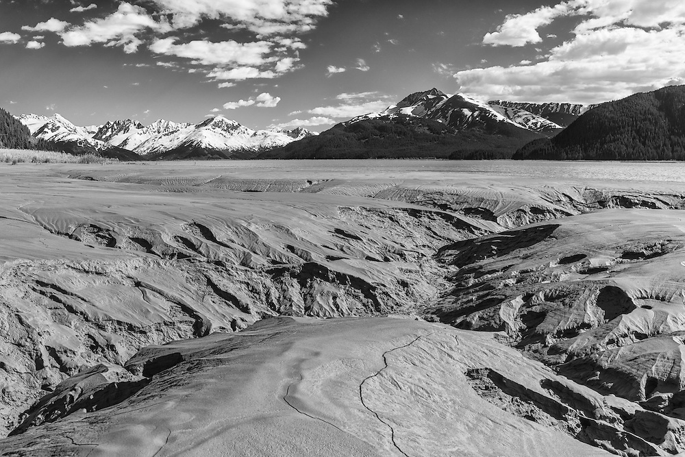 Channels in the tidal mud flats of Turnagain Arm in Southcentral Alaska. Spring. Afternoon.