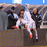 Ezequiel Lavezzi, Argentina, jumps the fence at the end of the game during the Argentina Vs Ecuador International friendly football match at MetLife Stadium, New Jersey. USA. 31st march 2015. Photo Tim Clayton