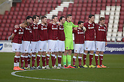 Cobblers players pay there respects to the people of Brussels during the Sky Bet League 2 match between Northampton Town and Newport County at Sixfields Stadium, Northampton, England on 25 March 2016. Photo by Dennis Goodwin.
