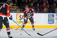 KELOWNA, CANADA - JANUARY 10: Cole Sanford #26 of Medicine Hat Tigers passes the puck against the Kelowna Rockets on January 10, 2015 at Prospera Place in Kelowna, British Columbia, Canada.  (Photo by Marissa Baecker/Shoot the Breeze)  *** Local Caption *** Cole Sanford;