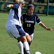 UNCW's Maddie McCormick battles Longwood's Katie Beebe for the ball.