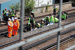 © Licensed to London News Pictures. 18/06/2018. London, UK. Emergency services remove bodies from the tracks near Loughborough Junction station after it was reported that three people have been killed after being hit by a train. Photo credit: Rob Pinney/LNP