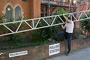 On the morning of the European Elections in the UK, a lworkman carefully takes saffolding over a wall outside the Polling Station at the Baptist Church at the Baptist Church in East Dulwich, on 23rd May 2019, in south London, England UK.