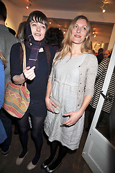 Left to right, IRIS PALMER and LUCY MCMILLAN-SCOTT at a private view entitled 'No Love Lost' by artists Daisy de Villeneuve and Natasha Law held at Eleven, 11 Eccleston Street, London SW1 on 31st March 2009.