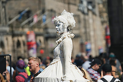 Edinburgh, Scotland, UK. 3 August 2019. On the first weekend of the Edinburgh Fringe Festival good weather brought out thousands of tourists to enjoy the many street performers  on the Royal Mile in Edinburgh Old Town. Pictured Lady Whistle street artist. Iain Masterton/Alamy Live News