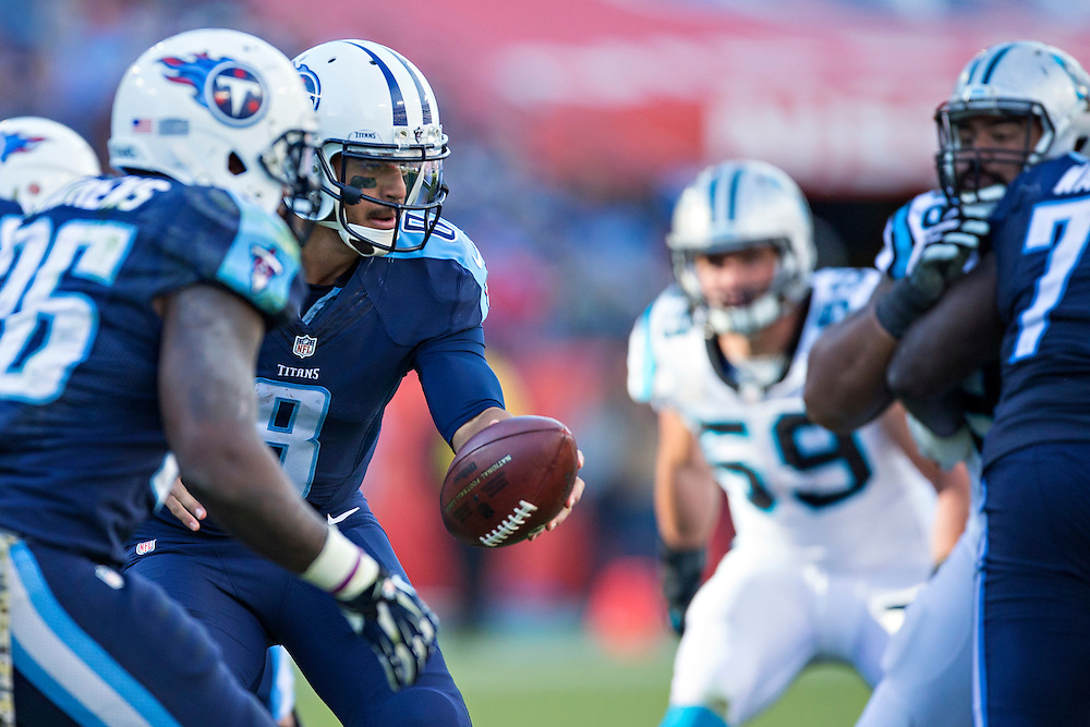 NASHVILLE, TN - NOVEMBER 15:  Marcus Mariota #8 of the Tennessee Titans turns to make a hand off during a game against the Carolina Panthers at Nissan Stadium on November 15, 2015 in Nashville, Tennessee.  (Photo by Wesley Hitt/Getty Images) *** Local Caption *** Marcus Mariota