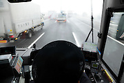 public transportation bus driving on the highway during bad weather Japan
