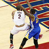 10 June 2016: Cleveland Cavaliers guard Kyrie Irving (2) goes for the layup against Golden State Warriors forward Draymond Green (23) during the Golden State Warriors 108-97 victory over the Cleveland Cavaliers, during Game Four of the 2016 NBA Finals at the Quicken Loans Arena, Cleveland, Ohio, USA.