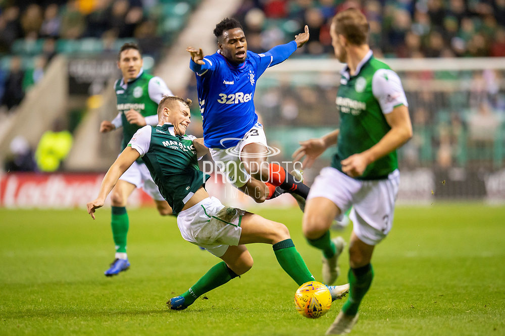 Ryan Porteous (#36) of Hibernian FC puts in a crunching tackle on Lassana Coulibaly (#23) of Rangers FC during the Ladbrokes Scottish Premiership match between Hibernian and Rangers at Easter Road, Edinburgh, Scotland on 19 December 2018.
