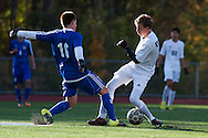 Mount Anthony's Garrett Derosia (16) and Burlington's Madey Madey (3)during the quarterfinal boys soccer game between Mount Anthony and Burlington at Buck Hard Field on Friday afternoon October 23, 2015 in Burlington. (BRIAN JENKINS/ for the FREE PRESS)