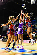 Maia Wilson of the Stars shoots under pressure from Jane Watson of the Tactix and Temalisi Fakahokotau of the Tactix during the ANZ Premiership Netball match, Tactix V Stars, Horncastle Arena, Christchurch, New Zealand, 23rd May 2018.Copyright photo: John Davidson / www.photosport.nz