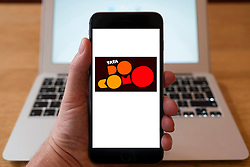 Using iPhone smartphone to display logo of Tata Docomo , the Indian cellular service provider