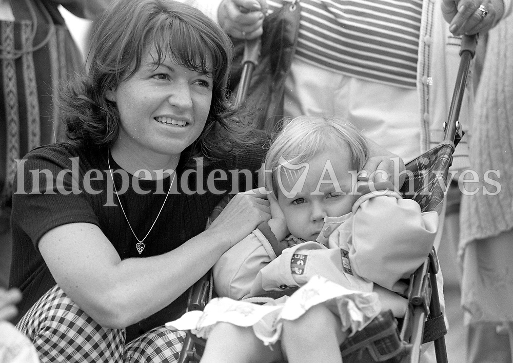 Three Year Old Aisling Kavanagh from Perrystown, Dublin, found the noise from the Aer Corps Helicopter takes-off from Dun Laoghaire Pier, Dublin, 23/06/1996 (Part of the Independent Newspapers Ireland/NLI Collection).