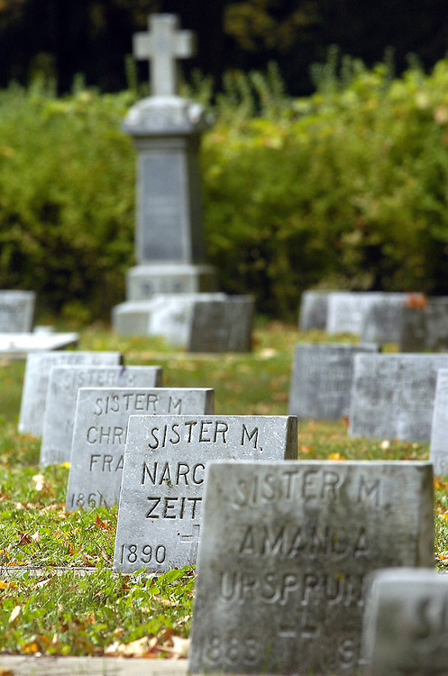 CEMETERY SCENE -- Headstones on the graves of religious sisters form a line at Saint Francis Seminary Cemetery in St. Francis. All Souls Day is observed Nov. 2. (Photo by Sam Lucero)