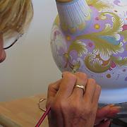 Hand painting of ceramics designs in ceramics factory in Deruta, Italy