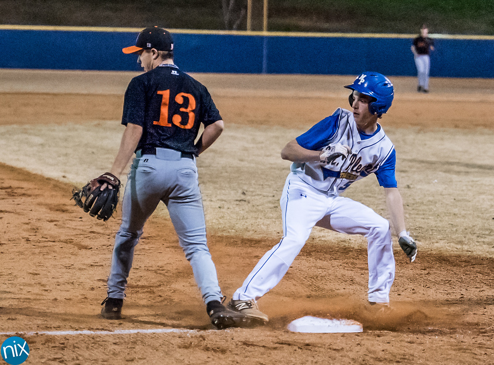 Mount Pleasant's Logan Mauldin (5) makes it to third base against Northwest Cabarrus Wednesday night at Mount Pleasant High School.
