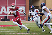 FAYETTEVILLE, AR - NOVEMBER 22:  Brandon Allen #10 of the Arkansas Razorbacks tries to avoid the rush from Issac Gross #94 of the Ole Miss Rebels at Razorback Stadium on November 22, 2014 in Fayetteville, Arkansas.  The Razorbacks defeated the Rebels 30-0.  (Photo by Wesley Hitt/Getty Images) *** Local Caption *** Brandon Allen; Issac Gross