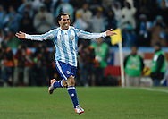 Argentina's midfielder Carlos Tevez celebrates after scoring the team's third goal against Mexico during the World Cup South Africa 2010 before quarters final football  match, at Soccer City stadium, in Johannesburgo, South Africa, on June 27, 2010.  (Alejandro Pagni/PHOTOXPHOTO)