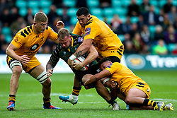 Mitch Eadie of Northampton Saints is tackled by Gabriel Oghre, Jeff Toomaga-Allen and Jack Willis of Wasps - Mandatory by-line: Robbie Stephenson/JMP - 28/09/2019 - RUGBY - Franklin's Gardens - Northampton, England - Northampton Saints v Wasps - Premiership Rugby Cup
