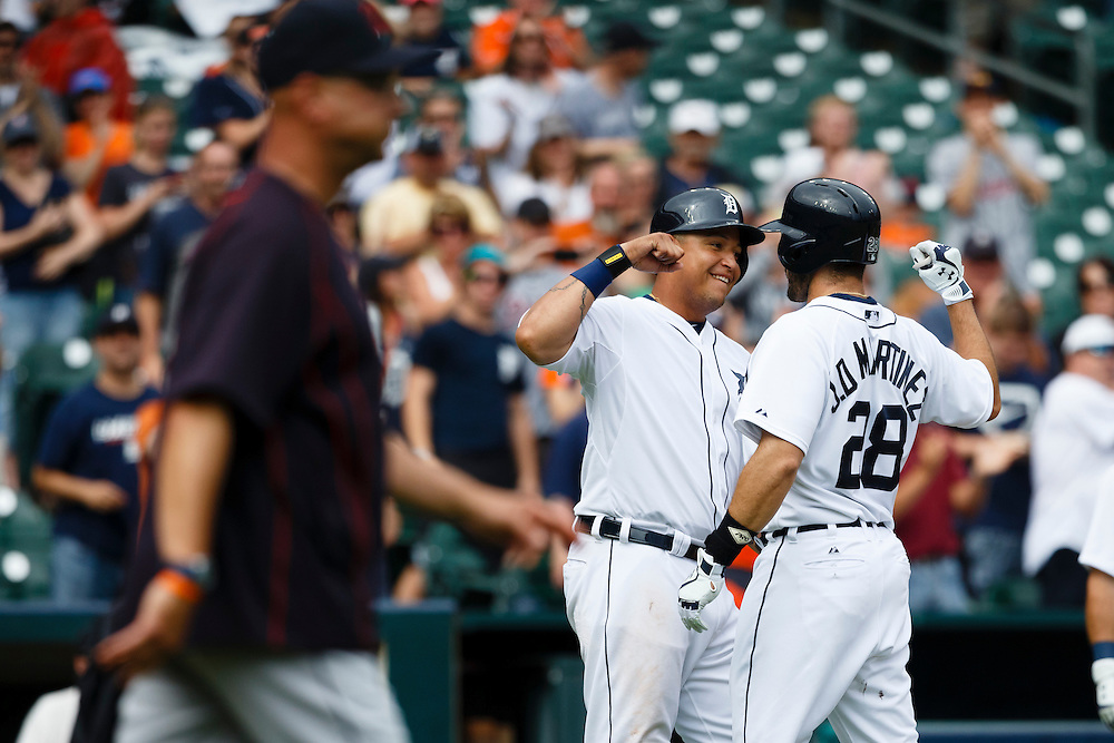 Jun 14, 2015; Detroit, MI, USA; Detroit Tigers right fielder J.D. Martinez (28) receives congratulations from first baseman Miguel Cabrera (24) after he hits a three run home run in the sixth inning as Cleveland Indians manager Terry Francona (17) walks out to relieve relief pitcher Scott Atchison (not pictured) at Comerica Park. Mandatory Credit: Rick Osentoski-USA TODAY Sports