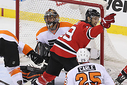 May 3, 2012; Newark, NJ, USA;  New Jersey Devils center Travis Zajac (19) and Philadelphia Flyers goalie Ilya Bryzgalov (30) react after a goal by New Jersey Devils center Patrik Elias (26) during the first period in game three of the 2012 Eastern Conference semifinals at the Prudential Center.