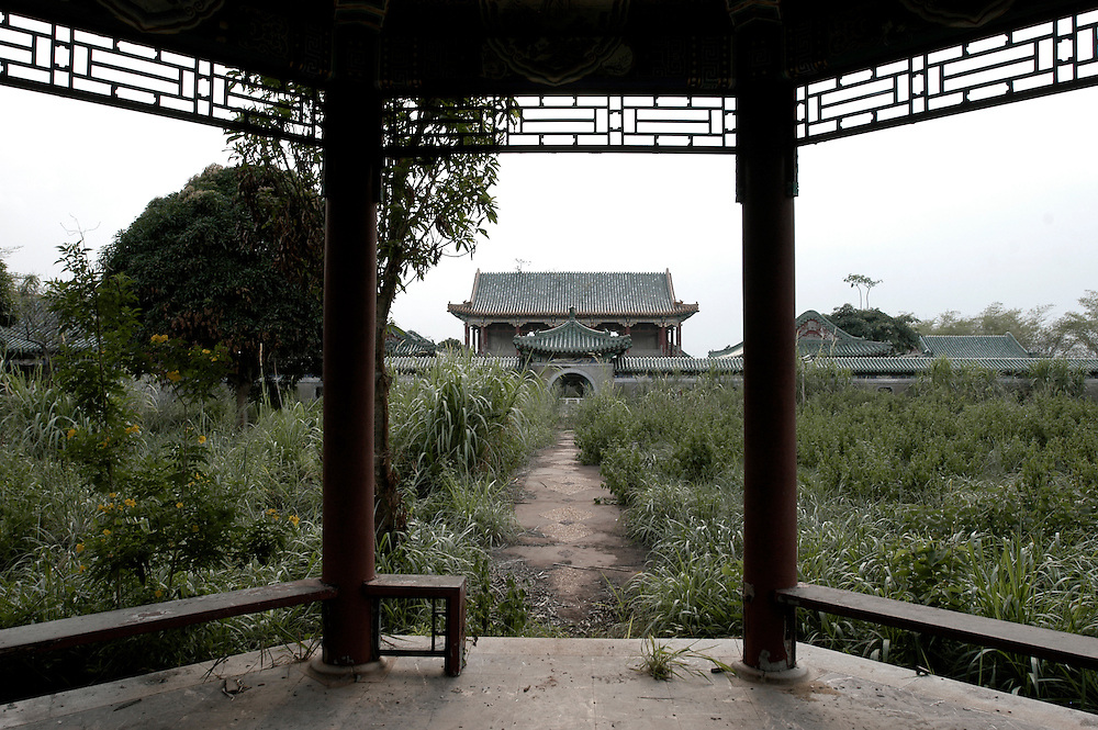 The remains of the Peking Palace, one of three extravagant residences built by the former ruler of Zaire Mobutu Sese Seko in and around his native village of Gbadolite in Equateur province. The elaborate complex of Chinese pagodas is said to be an exact replica of the Forbidden City. The town and properties were looted by rebel forces during the country's civil war..Kawele, DR Congo. 18/03/2009..Photo © J.B. Russell