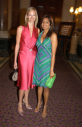 Left to right, DARCEY VIGORS and DIVIA LALVANI at a fashion show and dinner hosted by Shangri-la Hotels and Resorts and Andy Wong featuring fashion by new designer Lu Kun held at The Goldsmiths Hall, Foster Lane, London on 25th April 2005.<br />