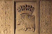 Porcupine with a crown, representing King Louis XII, and candelabra, relief on a fireplace in the Lower Room of the Hotel Lallemant, a mansion built 1495-1518 in French Renaissance style by the Lallemant merchant family, in Bourges, Centre Val de Loire, France. The fireplace is carved with coats of arms and also royal emblems representing Louis XII and Anne of Brittany (the ermine), who both visited Bourges in 1506. The sculptural decoration on the building, made by both French and Italian sculptors, has been interpreted by Fulcanelli and others as having an alchemical symbolism. Since 1951 the building has housed the Musee des Arts Decoratifs and it was listed as a historic monument in 1840. Picture by Manuel Cohen