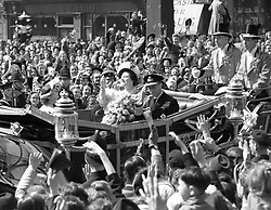 The scene at Ludgate Circus, London, as the King and Queen wave to well wishers as they make their way to St. Paul's Cathedral to celebrate their silver wedding anniversary.<br />