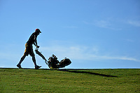 Lonnie Poole Golf Course groundskeeper mows a green.