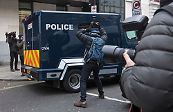 © Licensed to London News Pictures. 06/12/2017. London, UK. Media surround an armoured Police vehicle carrying terror suspects Naa'imur Zakariyah Rahman, 20, and Mohammed Aqib Imran, 21, as it leaves Westminster Magistrates Court in London where they are accused of plotting an attack at Downing Street to kill British prime minister Theresa May. Photo credit: Ben Cawthra/LNP