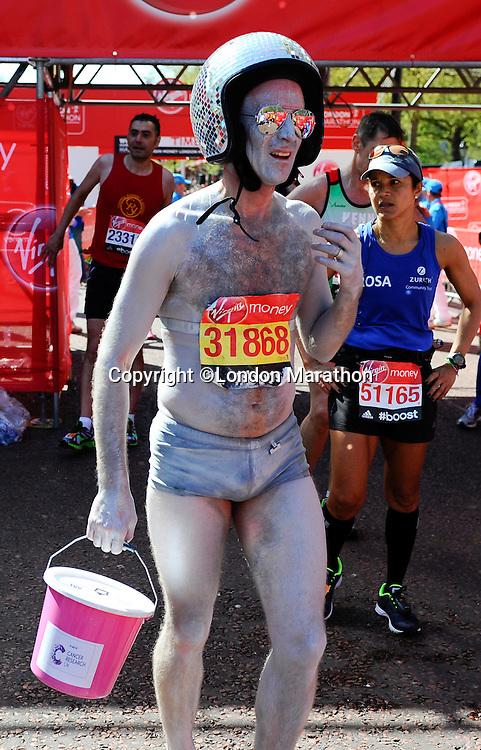 A happy runner after completing the race<br /> The Virgin Money London Marathon 2014<br /> 13 April 2014<br /> Photo: Javier Garcia/Virgin Money London Marathon<br /> media@london-marathon.co.uk