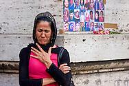 Roma, 21 Luglio 2015<br /> Manifestazione della Rete Kurdistan che ha  protestato davanti Ufficio Cultura dell'Ambasciata di Turchia, dopo un attacco terroristico suicida in Suruc,provocato da una giovanw kamikaze dell'ISis, dove 32 persone sono morte e 100 sono rimaste ferite il 20 luglio 2015. Donna curda piange quando vengono ricordati i nomi delle persone uccise nell'attentato.<br /> Rome, Italy. 21st July 2015 <br /> Dozens of people of the Network Kurdistan in Rome,  protested in front  Office  of the Culture of the Embassy of Turkey after a suicide terror attack in Suruc, where 32 people died and 100 are injured on July 20, 2015. Kurdish woman weeps when they remember the names of those killed in the attack.