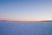 The pink and blue skies of an arctic dusk during a British mountaineering expedition to Knud Rasmussens Land, East Greenland, Arctic, 2006.