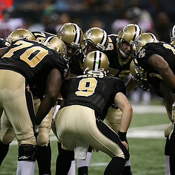 2007 October, 21: New Orleans Saints quarterback Drew Brees (9) calls a play from the huddle during a 22-16 win by the New Orleans Saints over the Atlanta Falcons at the Louisiana Superdome in New Orleans, LA.
