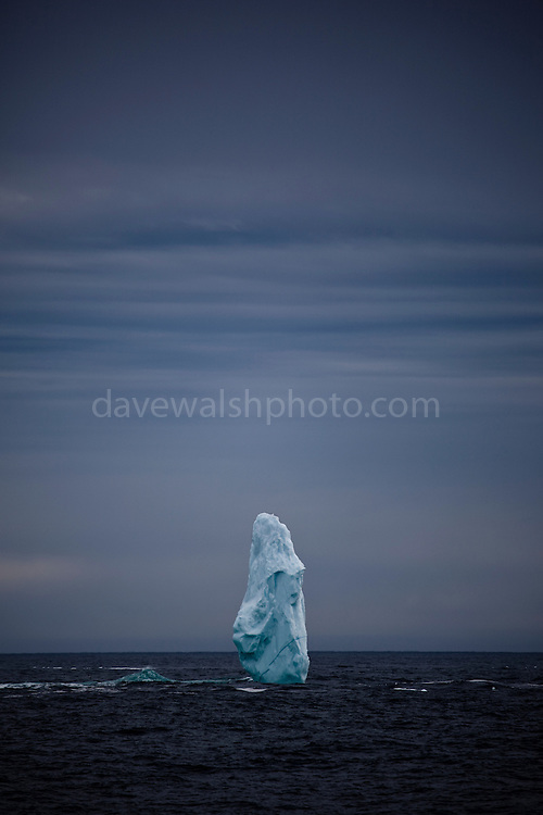 "Pinnacle of ice near the mouth of Kangerlugussuaq Fjord, East Greenland. The structure is part of a large iceberg, not pictured, worn away by wind and waves. This mage can be licensed via Millennium Images. Contact me for more details, or email mail@milim.com For prints, contact me, or click ""add to cart"" to some standard print options."