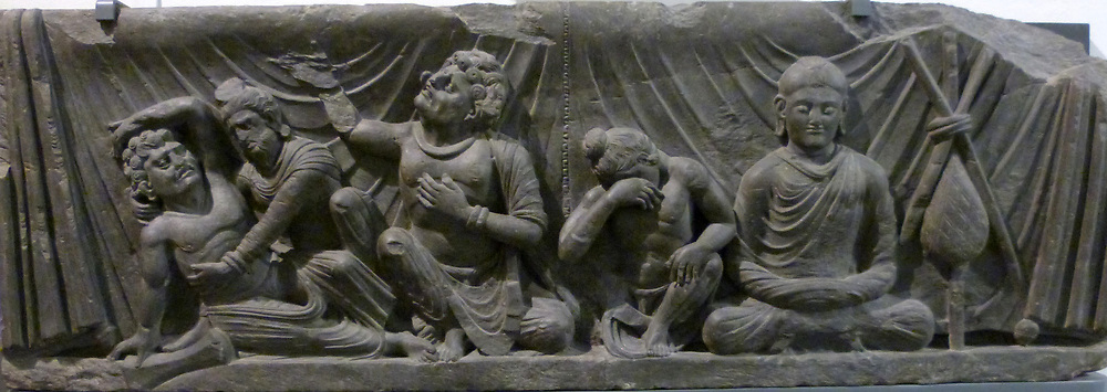 Prince Siddhartha (The Buddha) 100-300 goes to school (100-300) Kushan Period.  The Buddha is shown in his childhood. He is seated in a chariot pulled by rams.