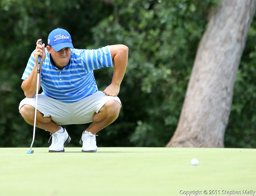 Gregory O'Mahony of Tequesta, Florida studies the green on the 14th hole during the first round of the Greater Cedar Rapids Open held at Hunters Ridge Golf Course in Marion on Friday, July 22, 2011.