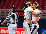 26 Nov. 2010 -- ST. LOUIS -- Mound City High School quarterback Lucas Schawang (7, right) is congratulated by teammate Kase Newcomb (2) after scoring a touchdown against St. Joseph Christian School during MSHSAA 8-man football championship game at the Edward Jones Dome Friday, Nov. 26, 2010. Image © copyright 2010 Sid Hastings.