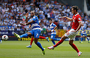 Charlie Austin and Patrick Bauer jump for a header during the Sky Bet Championship match between Charlton Athletic and Queens Park Rangers at The Valley, London, England on 8 August 2015. Photo by Andy Walter.