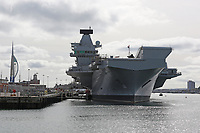 HMS Queen Elizabeth (R08) is the Royal Navy's newest and largest warship (70,600 tonnes) ever built and is capable of carrying up to 40 aircraft. It is designed to operate V/STOL aircraft, the air wing will consist of F-35B Lightning II multirole fighters and Merlin helicopters for airborne early warning and anti-submarine warfare. Princess Royal Jetty, HM Naval Base Portsmouth UK