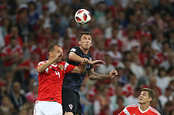 SOCHI, July 7, 2018  Sergey Ignashevich (L) of Russia competes for a header with Mario Mandzukic (C) of Croatia during the 2018 FIFA World Cup quarter-final match between Russia and Croatia in Sochi, Russia, July 7, 2018. (Credit Image: © Cao Can/Xinhua via ZUMA Wire)