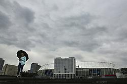 May 13, 2018 - Kiev, Ukraine - A woman walks near NSC Olimpiyskiy in Kyiv, Ukraine, May 13, 2018. Kyiv prepares to host UEFA Women's Champions League final between Wolfsburg and Lyon at Valeriy Lobanovskiy Dynamo Stadium on 24 May, 2018 and the UEFA Champions League final match between Real Madrid and  Liverpool at NSC Olimpiyskiy Stadium on Saturday 26 May, 2018. (Credit Image: © Sergii Kharchenko/NurPhoto via ZUMA Press)